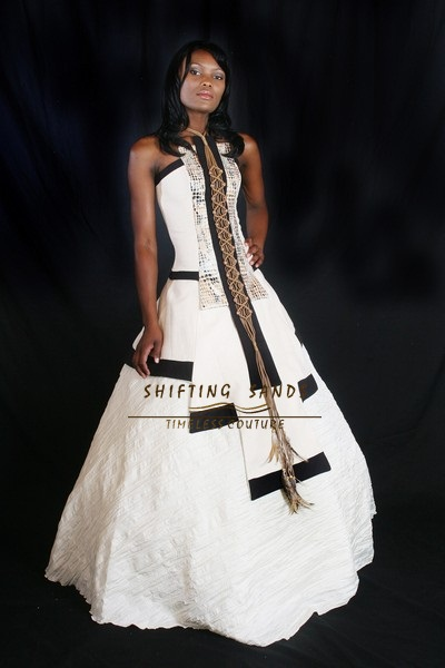 Traditional ladies shifting sands african couture for Leather wedding dresses black