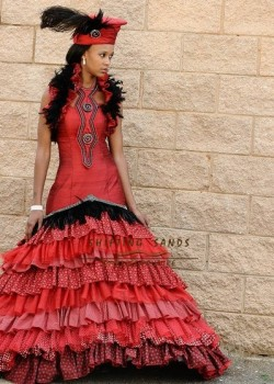 Shifting Sands Traditional African Zulu inspired red silk and shwe shwe frill wedding dress with hat